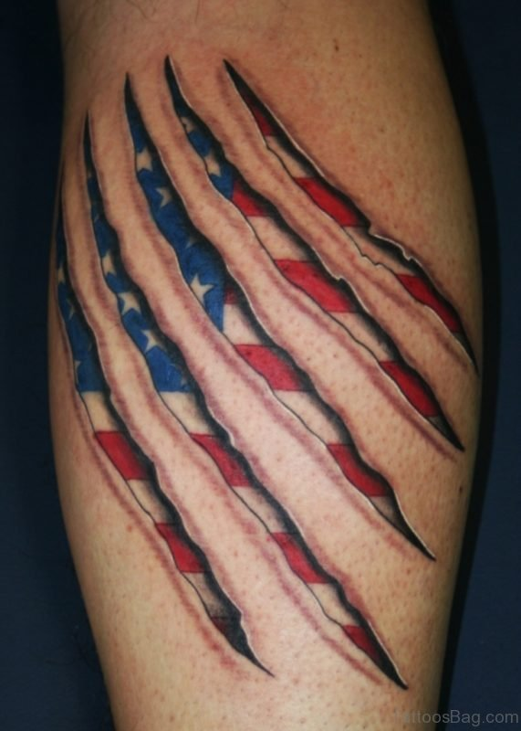 Patriotic Ripped Skin Tattoo On Shoulder