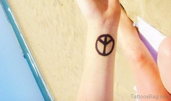 Peace Sign Tattoo On Wrist