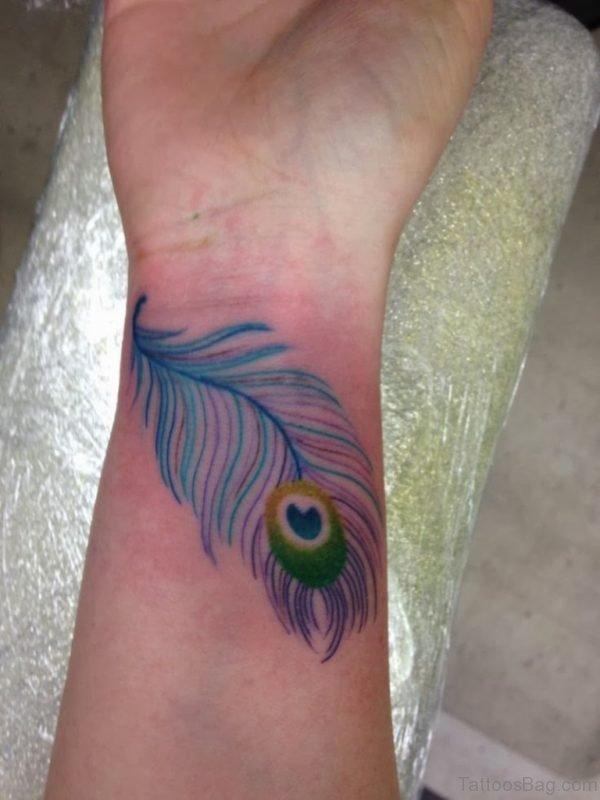 Peacock Feather Wrist Tattoo