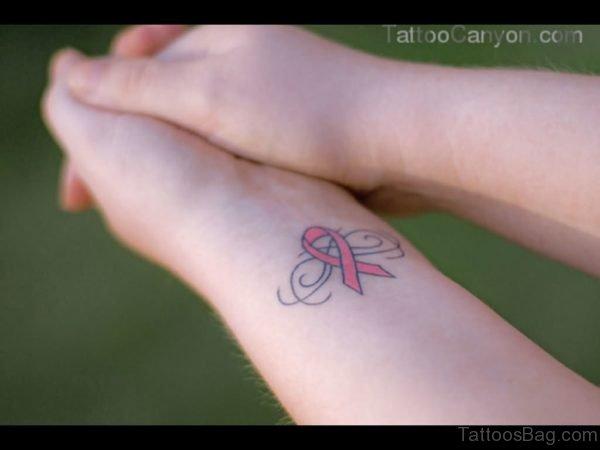 Pink Cancer Ribbon Wrist Tattoo