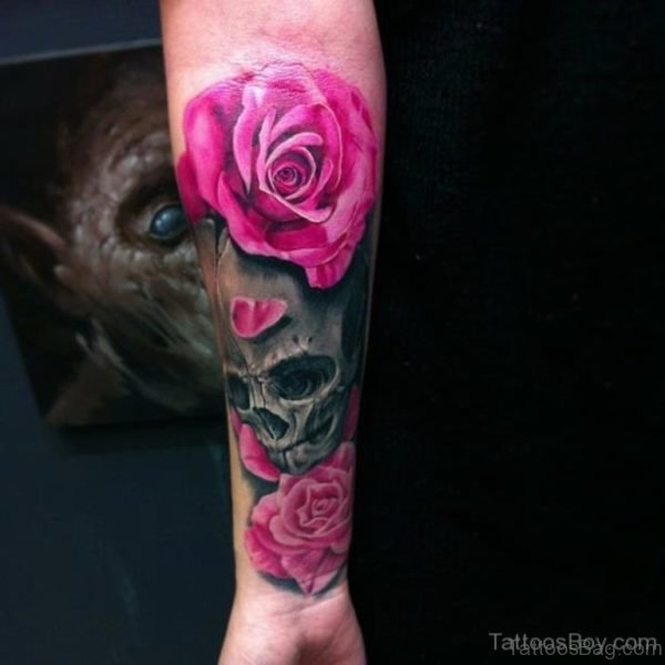 Pink Rose And Skull Tattoo On Wrist