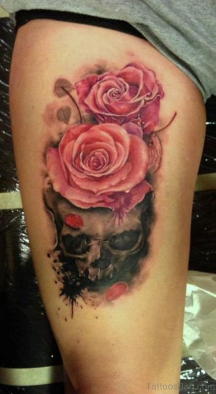 Pink Roses On Skull Tattoo On Thigh