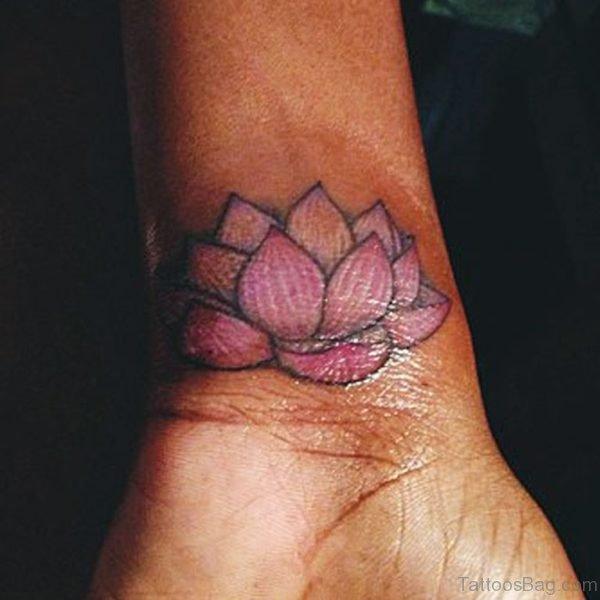 Nice Pink Lotus Tattoo On Wrist