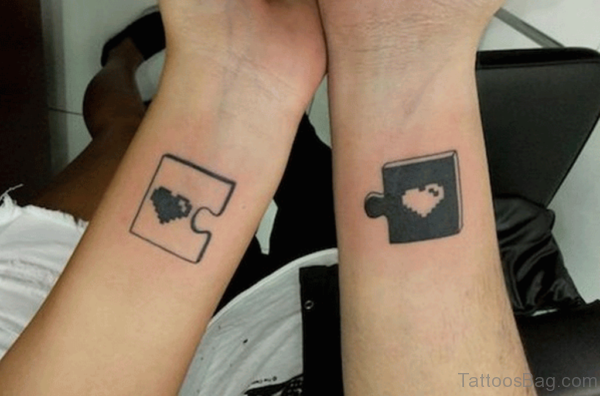 Puzzle Love Tattoo On Wrist