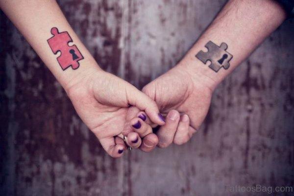 Puzzle Piece Matching Tattoo On Wrist