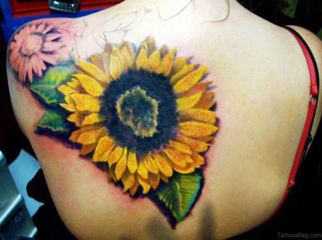 85 pretty sunflower tattoos designs for back for Sunflower hip tattoo