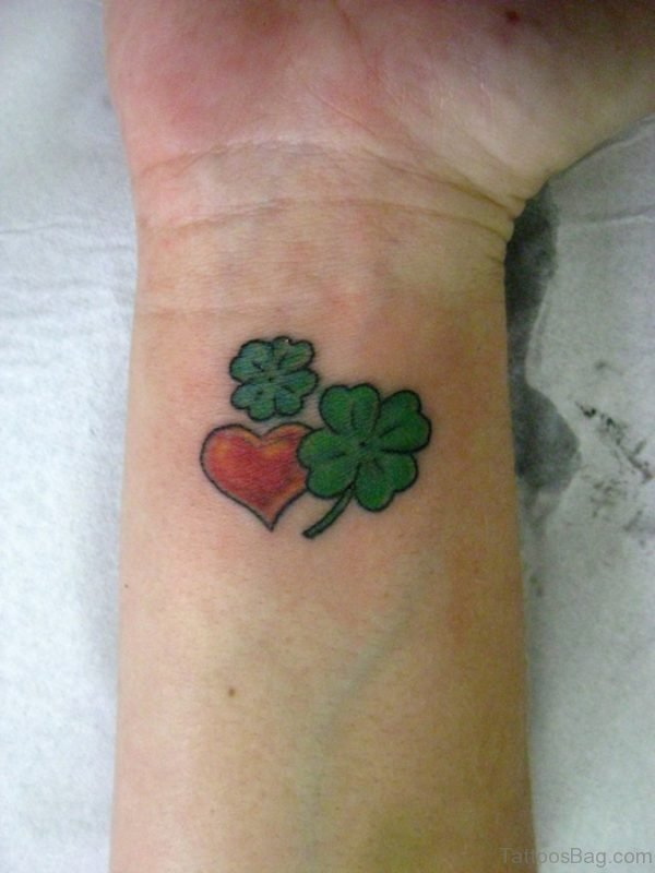 Red And Green Heart Tattoo On Wrist