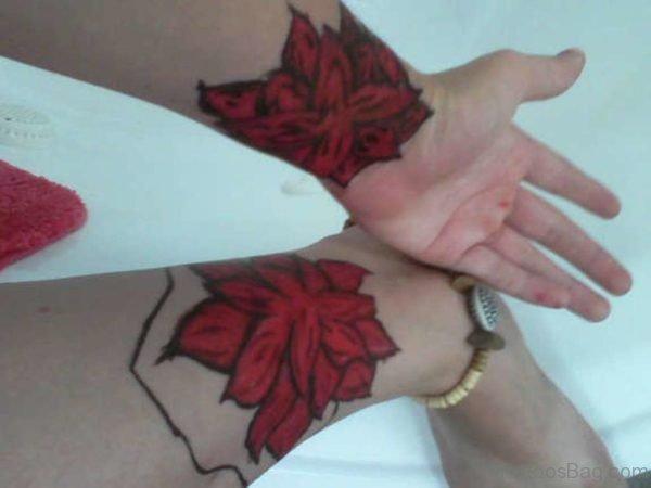 Red Flower Tattoo On Wrist