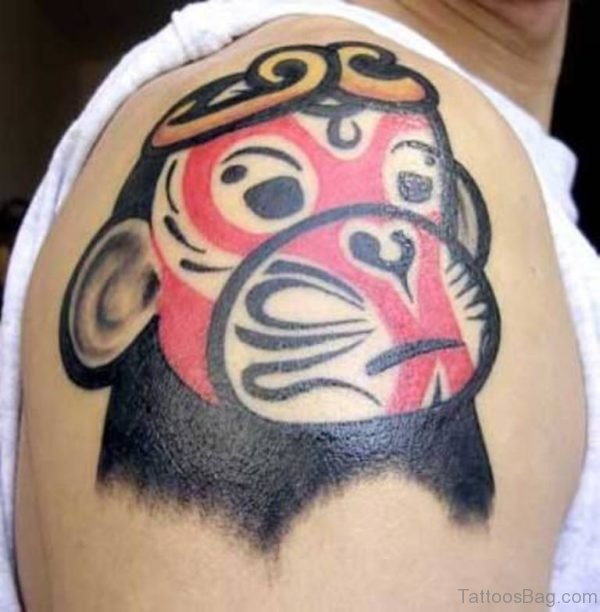 Red Monkey Face Shoulder Tattoo
