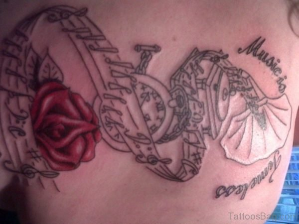 Red Rose And Music Notes Tattoo