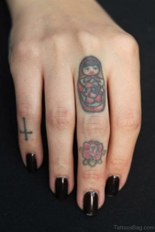 Red Rose Tattoo On Middle Finger
