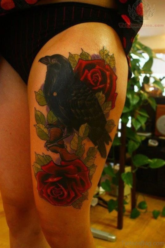Red Roses And Crow Tattoo On Thigh