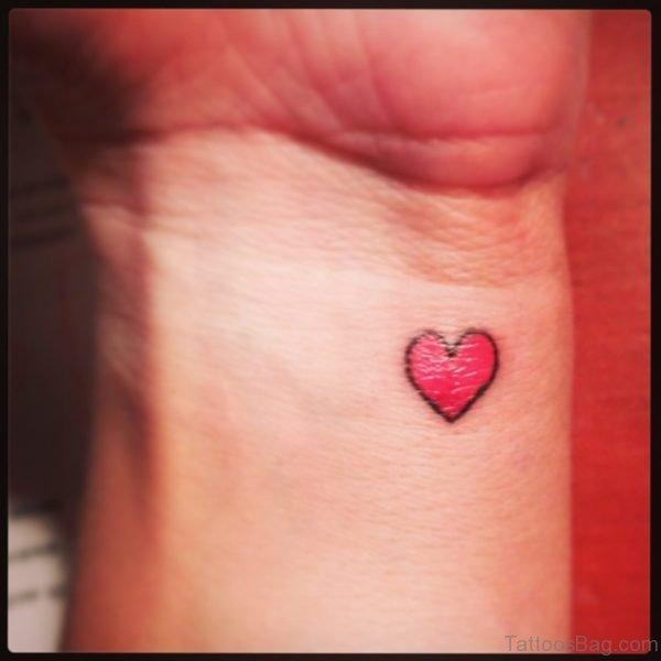 Red Shinning Heart Tattoo
