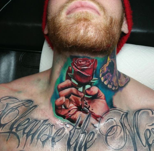 Rose And Hand Ripped Skin Tattoo