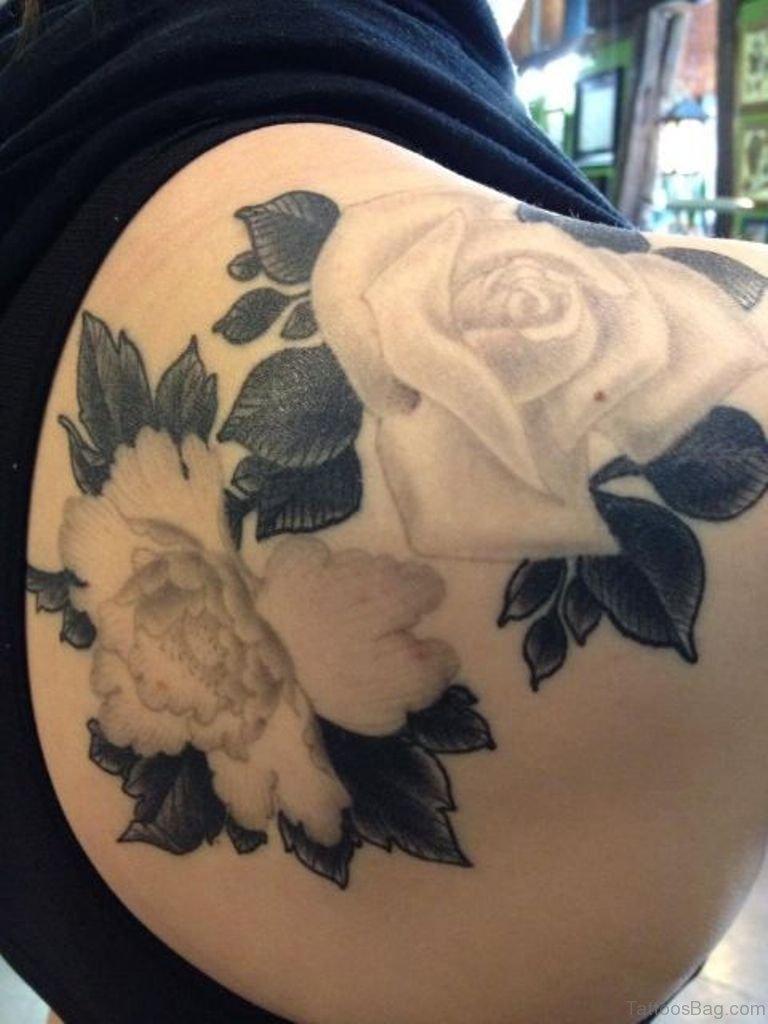 57 pleasant black rose tattoo designs for Female shoulder blade tattoos
