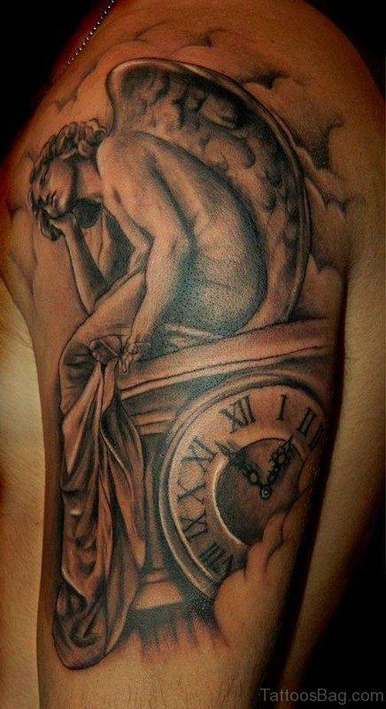 Sad Angel Shoulder Tattoo On Left Shoulder