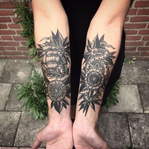 Ship And Snake Geometric Tattoo On Wrist