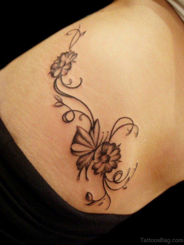 Simple Women Shoulder Tattoo