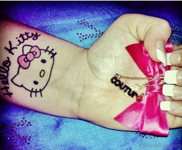 Simple And Beautiful kitty Wrist Tattoo