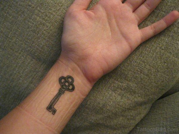 Simple Key Tattoo On Wrist