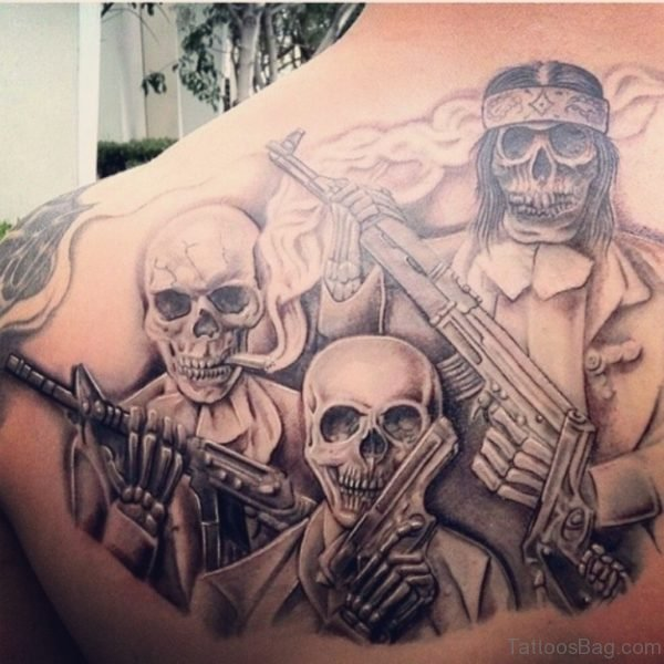 Skull And Gun Tattoo