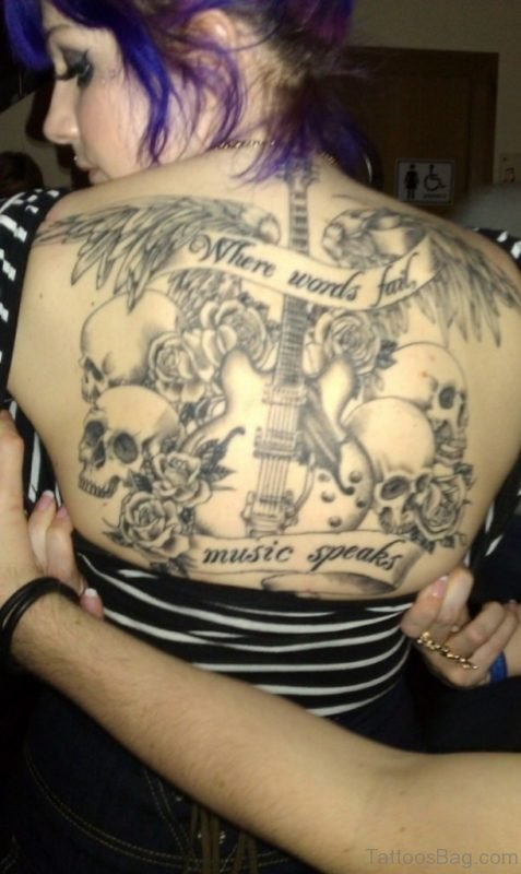 Skull And Music Notes Tattoo