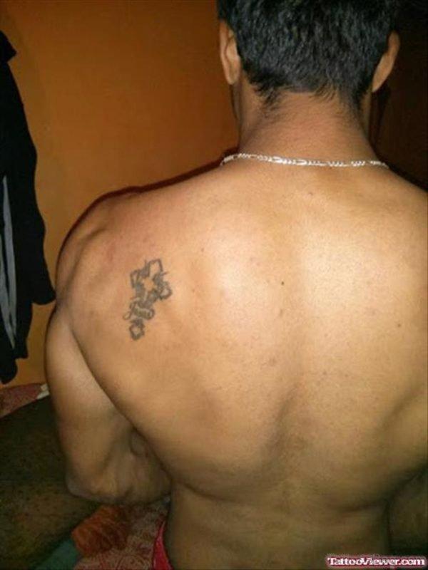 Small Cross Tattoo On Back
