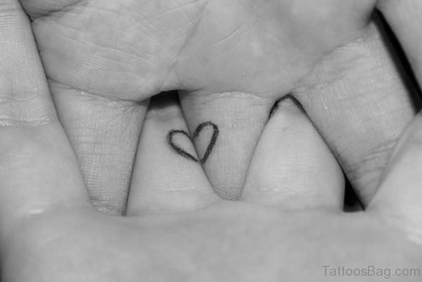 Small Heart Tattoo Design On Finger