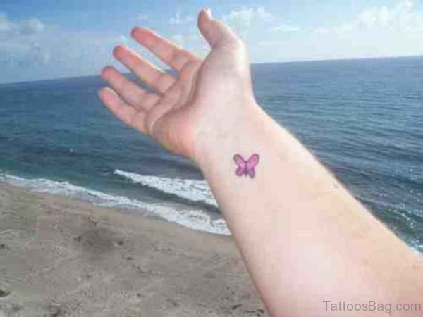 Small Pink Butterfly Tattoo On Wrist
