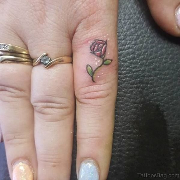 Small Red Rose Tattoo On Finger