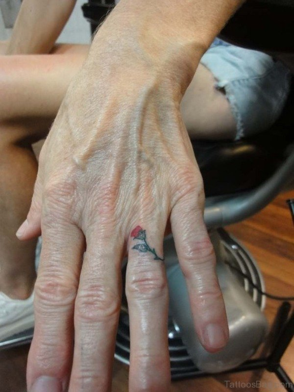 Small Rose Tattoo On Ring Finger