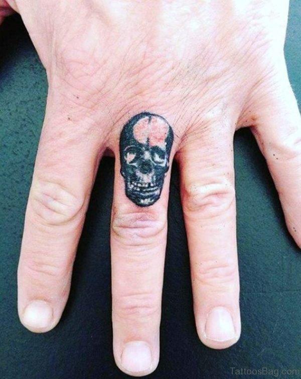 Small Skull Tattoo On Finger