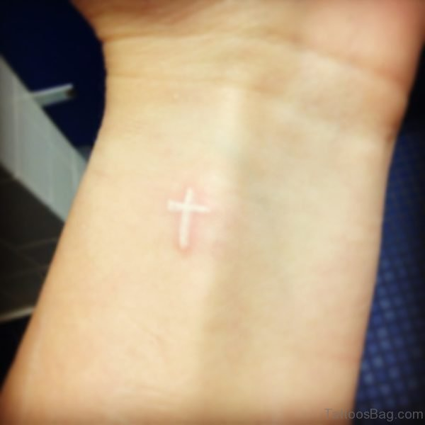 Small White Ink Cross Tattoo On Wrist