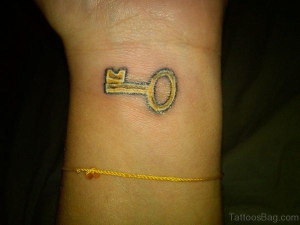 Small Yellow Key Tattoo For Wrist