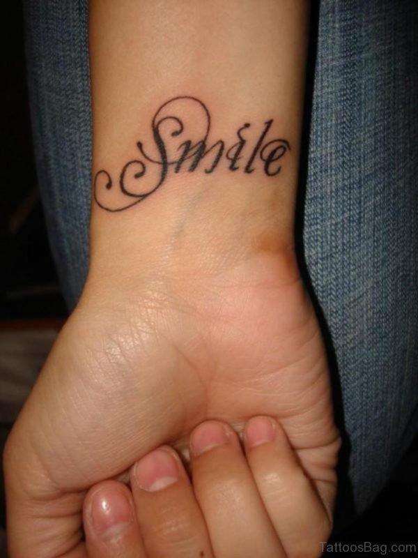 Smile Tattoo On Wrist
