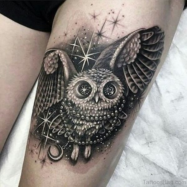 Sparkling Owl On Thigh Tattoo