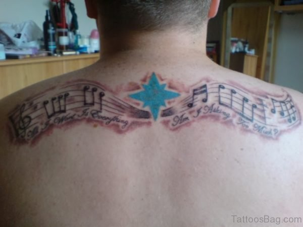 Star And Music Notes Tattoo