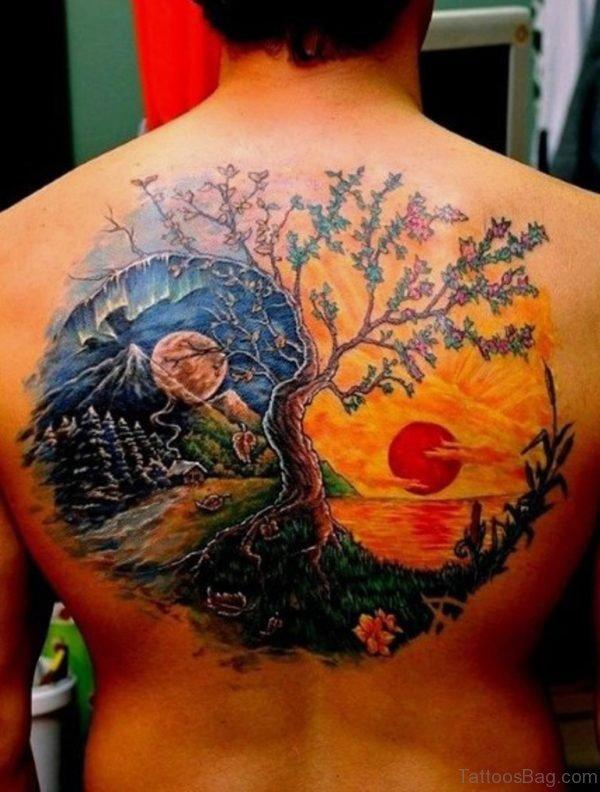 Sun And Moon Tattoo On Back-