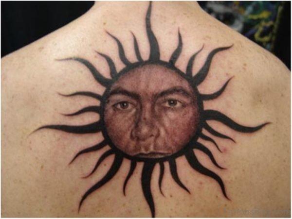 Sun Face Tattoo On Back