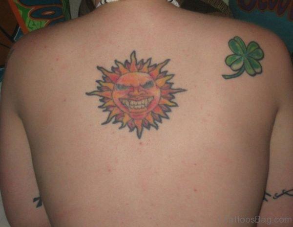 Sun and Clover Leaf Tattoo On Back