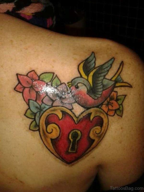 Swallow Heart Lock Tattoo On Back