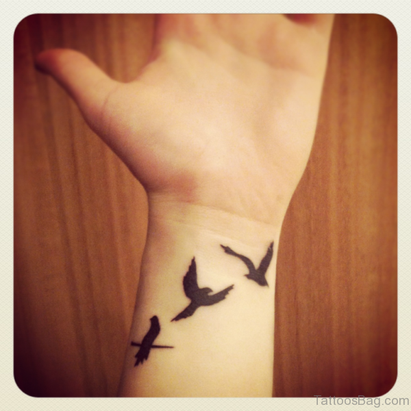 Three Flying Birds Tattoo On Wrist
