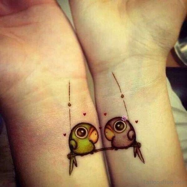 Tiny Bird Wrist Tattoo