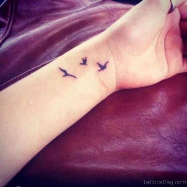 Tiny Birds Tattoo On Wrist