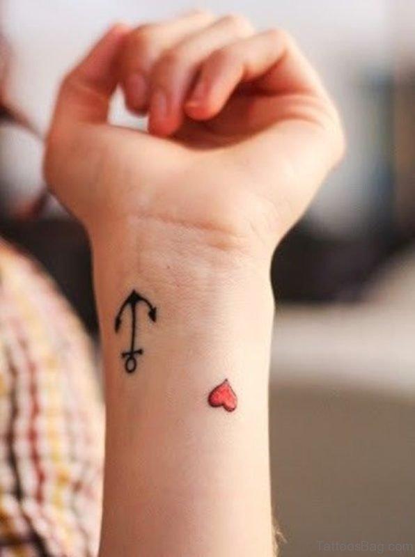 Tiny Heart Arrow Tattoo