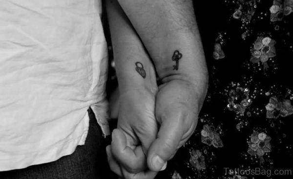 Tiny Key Tattoo
