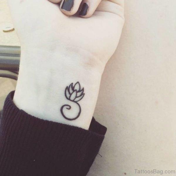 Tiny Lotus Flower Tattoo On Wrist