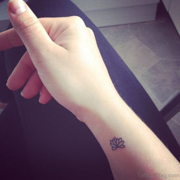 Tiny Lotus Tattoo