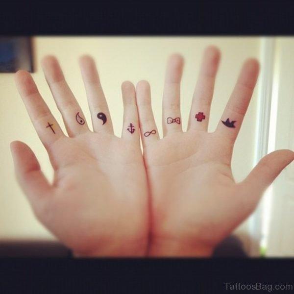 Tiny Symbol Tattoo