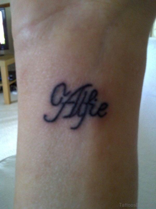 Tiny Word Tattoo On Wrist